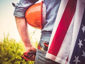Worker with an American flag